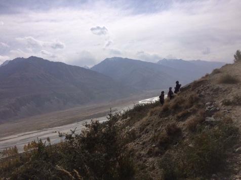 Schoolgirls walking home across the mountains in Pamirs